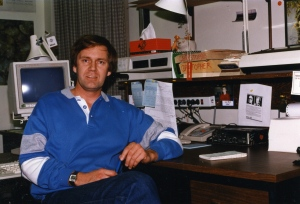 Author at his desk in the CBC Radio Newsroom in Edmonton.