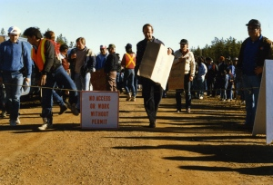 Herman Verbeek, Member of the European Parliament, carries a sign at the main checkpoint.