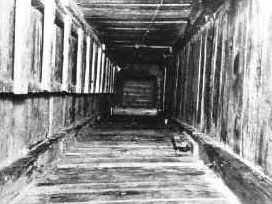 Tunnel dug by prisoners at Stalag Luft III [image courtesy of