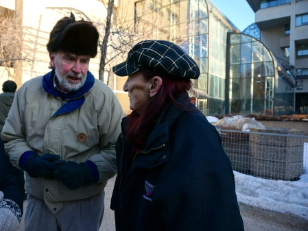 Former New Democrat MLA Jim Gurnett has words with Kyle Young's mother, Lorena, before the vigil began. [Photo by Author]