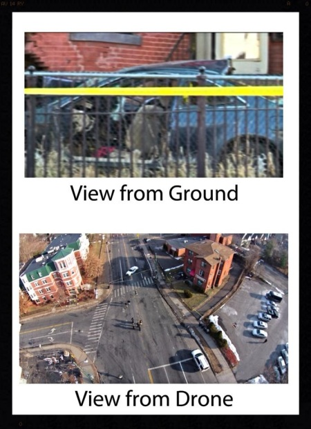 A comparison: an image taken on the ground by print journalists and by Rivera's drone.