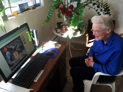 Doctor Huston at home in Edmonton watching a video on her computer showing workers in Nepal rescuing three men from a collapsed building. Photo shot on Sunday, 26 April 2015.