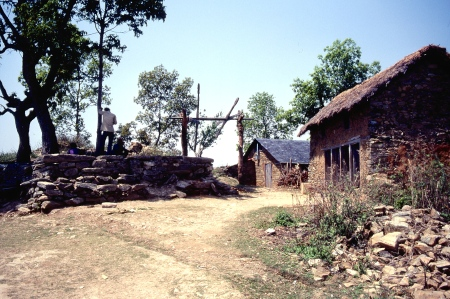 To the right is the school at Amp Pipal, where classes were taught by foreign missionaries who learned the Nepalese language.