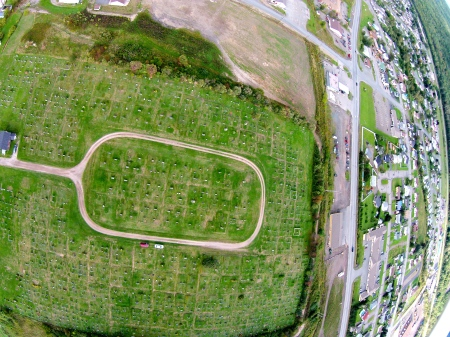 #7 - From 500 feet up, it looks like a tennis racket, but it's home to many tears and memories: the main graveyard in Campbellton. When I was a kid it was known at the Protestant Graveyard.