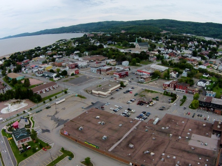 #12: Okay, no shopping centre roofs look exciting, I'll give you that. The Phantom rose 300 feet in the air to get this aerial of the east end of Campbellton. Hermini Thibeault of Campbellton assisted by keeping a close eye on the Phantom with his binoculars.