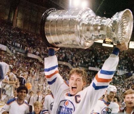 A jubilant Wayne Gretzky holds the Stanley Cup high. Photo courtesy of either the Edmonton Sun of the Edmonton Journal. I can't remember whose photographer snapped this great shot.