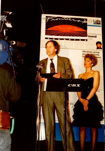 Accepting a 1991 reporting award from the Canadian Association of Journalists