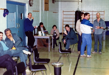 Click to enlarge. The scene that morning in the gym at the Max. Who's who, starting from left to right: Prisoner Jerry Crews [only partly in picture], killer of Edmonton Police Officer Ezio Farone; Prisoner Blair Pelletier, Saskatchewan killer; Deputy-Warden Al Swaine, leaning against the wall; an unidentified person making notes; Judy Fantham, manager of CBC Radio in Edmonton; prisoner Steve Ford [forget what he was in for, but it wasn't shoplifting]; Brad [Edmonton AM researcher], Gord McAlpine [CBC Sports announcer] and prisoner Dean Cooper [Calgary killer], holding a real coffee mug.
