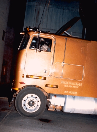 A burglary gone mad: the body of 47-year-old Gerry Thies in the cab of his transport truck. Thies died instantly. Click to enlarge.