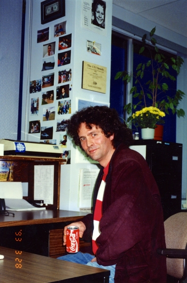 High on Coke: David Milgaard pays a visit to the CBC Radio Newsroom in Edmonton. He is sitting at my desk. Photo taken in March 1993.