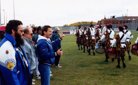 One of the socials organized in part by John Schimmens. The wail of bagpipers arriving in the prison's exercise yard gave the prisoners a lift. Notice one con [Ken] pumping his fist in the air.