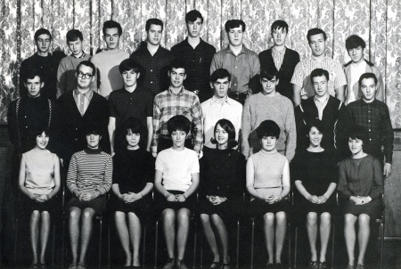 1967: Grade 11-A at Campbellton High. John McDonald [the tallest student] stands next to Brian MacNeish. Just in front of McDonald, stands Ken Chambers [with checkered shirt].