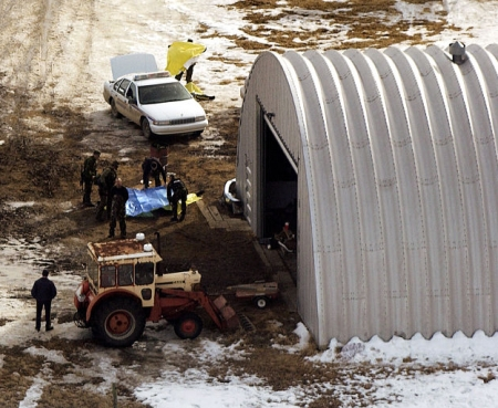 An aerial media shot shows police putting tarps over the dead officers.