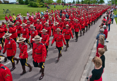 Mounties on their way to the Butterdome, in the University area, where the funeral service was held.