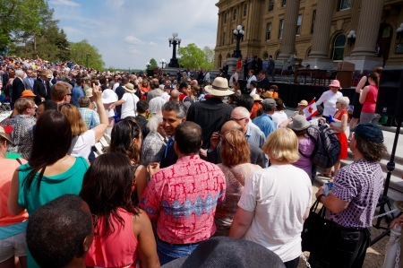 Alberta's new cabinet leaves the steps of the Legislature to greet people in the crowd.