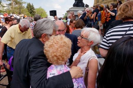 Former Edmonton Mayor Jan Reimer greets former NDP MLA Alex MacEachern.