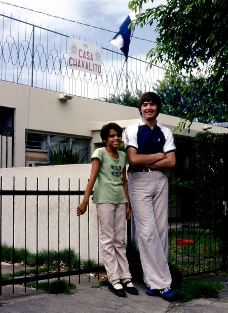 Sound technician Larry Arnault with a child outside Tacon's headquarters in Managua.