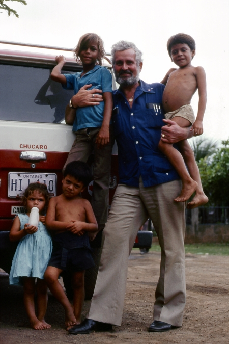 Peter Tacon with some children he met on a side street. These kids were not in care. The photo was used by the Canadian Press in a wire story that was picked up by many newspapers, including the Toronto Star.