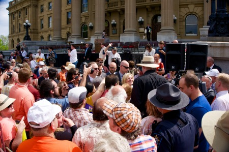 Rachel Notley greets a tall NDP supporter. Click to enlarge.