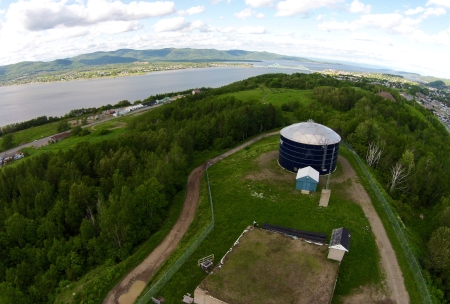 The water tower [also known as the pump house] on the eastern edge of Atholville, looking towards Campbellton. It was a great place for parking, so they tell me. A few kids got their start in life here.