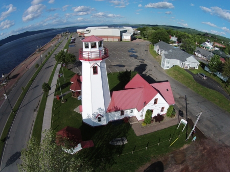 Campbellton's waterfront; the lighthouse is in fact a hostel.