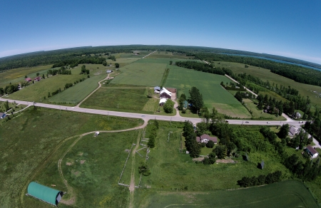 Centre of photo is the farm of White's parents, Carol and Larry Forbes. Near Wiarton, Ontario.