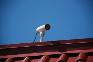 This surveillance camera was facing the parking lot. Photo taken on 23 June 2011. I do not know if this was the same camera back in July 2005.